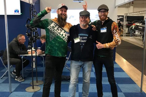 "From left to right: Mathias Larsson, Christer Borg, and Anders Holm. Mathias and Anders work as journalists at the leading Swedish sport fishing magazine ""Fiskejournalen"", and both joined #slutsnackat at the ""Sportfiskemässan"" last weekend, 29-31 March. The three stand in Älvräddarnas boot at the fair. Photo Credit: Christer Borg"